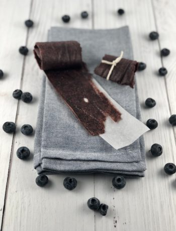 Mixed Berry Fruit Leathers on a parchment lined sheet.