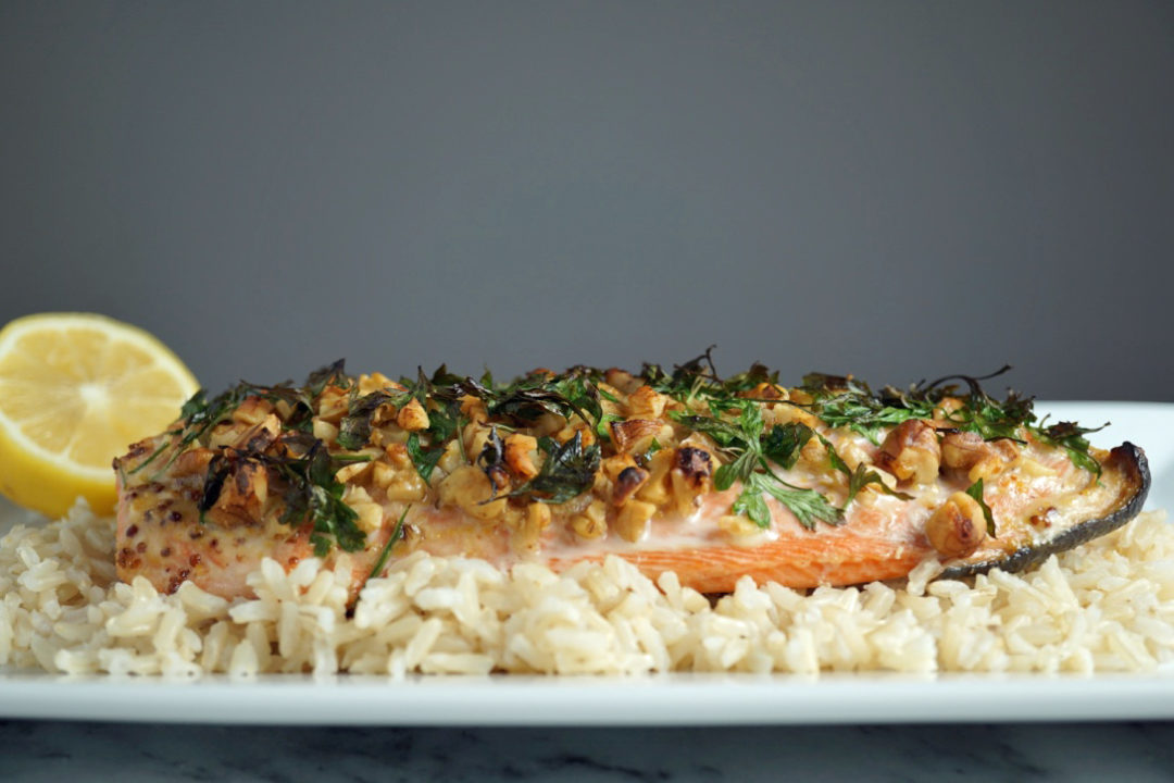 low FODMAP foods - pecan crusted salmon on top of brown rice
