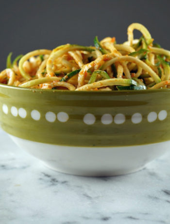 Zoodles in pasta sauce in a bowl on the counter