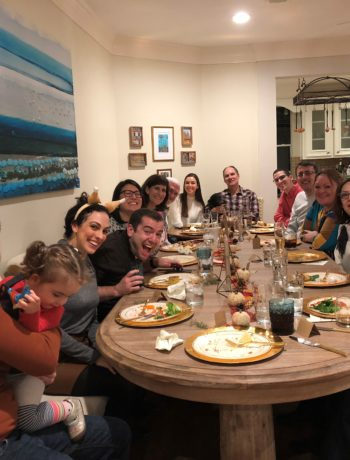 Thanksgiving dinner surrounded by family and friends