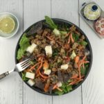 Turkey Taco Salad with Cilantro Vinaigrette in a large bowl on the counter top.
