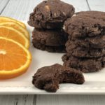 FODMAP cookies - Chocolate brownie cookies with candied oranges on a white plate